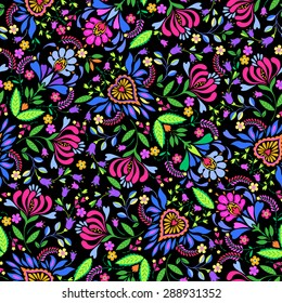 seamless vector  floral folk pattern. Colorful ethnic floral motif and ornaments, Polish wzory style, on black background. Vivid colors, happy flowers, allover layout.