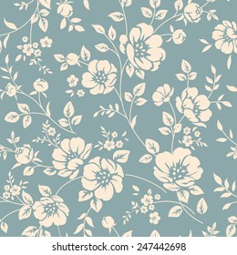Seamless vector floral wallpaper. Decorative vintage pattern in classic style with flowers and twigs. Two tone ornament with white peony silhouette on blue background