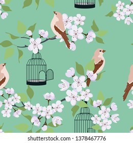 Seamless vector illustration with blossoming sakura and birds on a green background. For decoration of textiles, packaging, wallpaper.