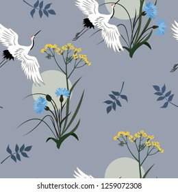 Seamless vector illustration with cornflowers, wild grasses and Japanese cranes. For decoration of textiles, packaging, wallpaper, web design.