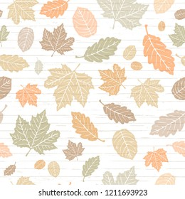 Seamless Vector Pastel Colored Autumn Falling Leaves on Shiplap Wood Plank Background. Great for holidays, Thanksgiving, invitations, stationery, greeting cards, fabric, paper crafting, & home decor.