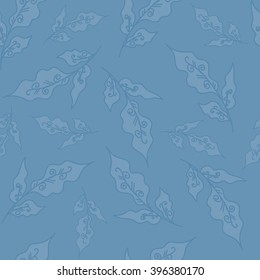 Seamless vector pattern. Beautiful leaves on a jeans background.