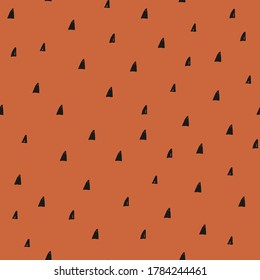 Seamless vector pattern with black triangles on rust background. Creative hand drawn pattern for holiday designs, party, birthday, invitation.