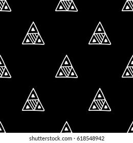 Seamless vector pattern. Black and white geometrical background with hand drawn decorative tribal elements. Print with ethnic, folk, traditional motifs. Graphic vector illustration