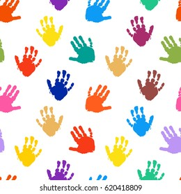 Seamless vector pattern from color prints of children's palms