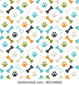 Seamless vector pattern. Colored dog footprint and bones texture: orange, blue, green and grey.