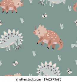 Seamless vector pattern with cute animal dinosaurs on a green background. Creative animal texture. Great for baby fabrics, textiles and designs
