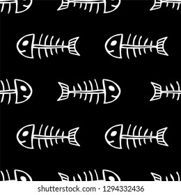 Seamless vector pattern of fish skeletons black and white