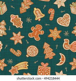 Seamless vector pattern with gingerbread cookies on emerald background. Christmas ornament