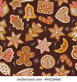 Seamless vector pattern with gingerbread cookies on brown background. Christmas vector wallpaper