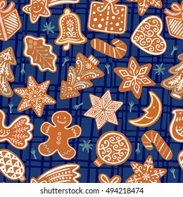 Seamless vector pattern with gingerbread cookies on blue background. Christmas ornament