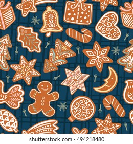 Seamless vector pattern with gingerbread cookies on dark blue background. Christmas wallpaper