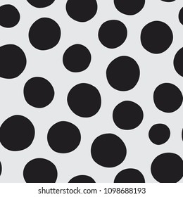 Seamless vector pattern of hand drawn polka dots, random spots in various sizes. Big and small dark circles in black and white. Stylish monochrome abstract background. Simple retro design elements.