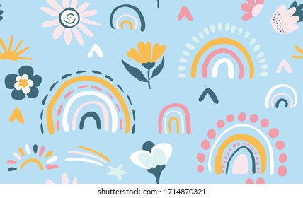 Seamless vector pattern with hand drawn rainbows and sun Trendy baby texture for fabric textile wallpaper apparel wrapping