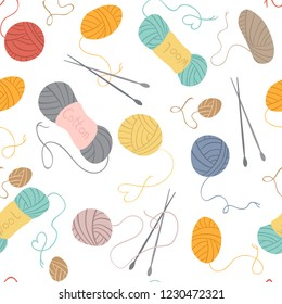 Seamless vector pattern. Knitting, yarn balls, knitting needles on a white background. Hobby and craft