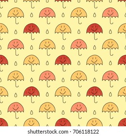 Seamless vector pattern made with colorful hand drawn umbrellas and drops of water. Autumn background