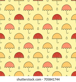Seamless vector pattern made with hand drawn colorful umbrellas and drops of water. Autumn background