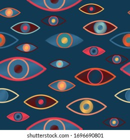 Seamless vector pattern with magical, witchcraft multi-colored eyes on a blue marine color background.Imitation of embroidery with threads on fabric.Fashionable and stylish design for fabric wallpaper
