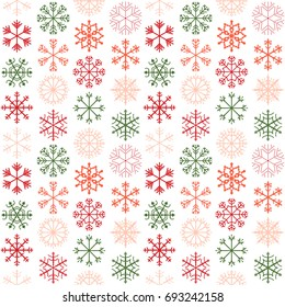 Seamless vector pattern with red, pink and green snowflakes for Christmas and winter holiday product designs, backgrounds and wrapping paper