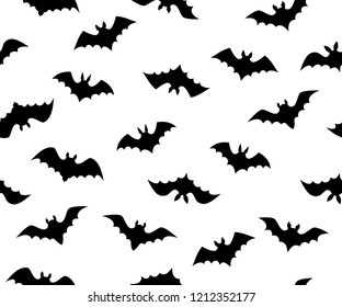 Seamless vector texture of various flying bat shapes. Different minimalistic black bats isolated on white background
