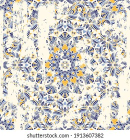 Seamless vintage pattern with an effect of attrition. Freehand drawing. Template seamless abstract pattern from floral mandala. Majolica pottery tile, blue, yellow azulejo. Portuguese and Spain decor
