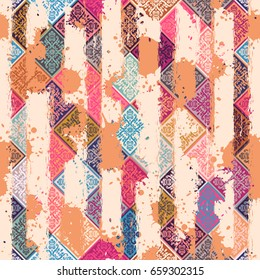Seamless vintage pattern with an effect of attrition. Patchwork tiles.