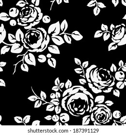 Seamless vintage pattern with flowers. Black monochrome background with flower silhouettes