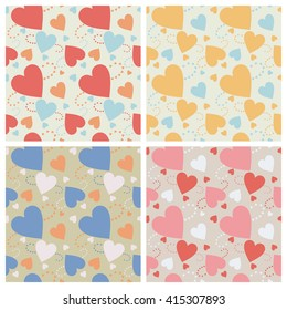 Seamless wall-paper hearts 2. A pattern multi-colored pastel hearts on a light background. Vector, EPS10. A print for fabric, photowall-paper, a background basis for design.