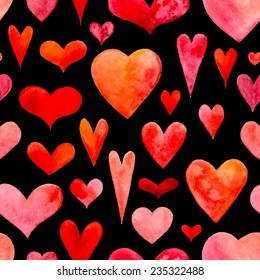 Seamless watercolor hearts pattern. Valentine's texture. Hand-drawn hearts on black background.