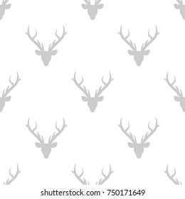 seamless winter pattern with  grey silhouette of deer head with antlers. vector flat Christmas ornament on white background