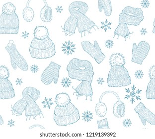 Seamless winter pattern. Knitted hats and mittens on a white background. Hand drawing, sketch