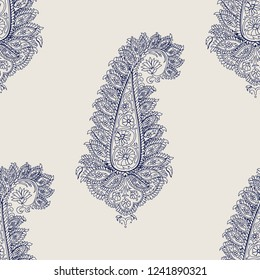 Seamless wood block printed indigo dye  ethnic paisley pattern. Traditional oriental ornament of India with flamboyant paisleys, navy blue on ecru background. Textile design.