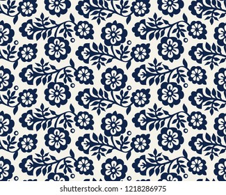 Seamless woodblock printed indigo dye floral pattern. Vector ethnic ornament, traditional Russian motif with blossoms, navy blue on ecru background. Textile print.