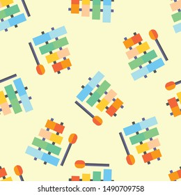 Seamless xylophone icon pattern on moccasin background. Simple flat vector design with bright colors for wrapping paper or web.