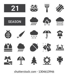 season icon set. Collection of 21 filled season icons included Clover, Ferris wheel, Pine, Umbrella, Oasis, Forest, Ice, Acorn, Rain, Birdhouse, Ladybird, Storm, Skii, Rake, Eggs