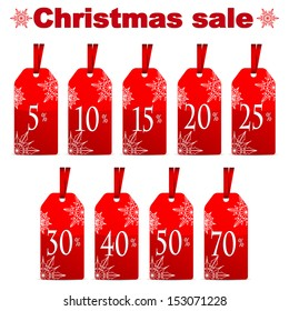 Seasonal Christmas sale.set of red price tags with percent discount isolated on white background.New Year clearance.vector