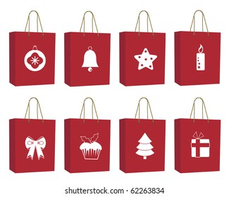 seasonal red christmas bags with motifs isolated on white