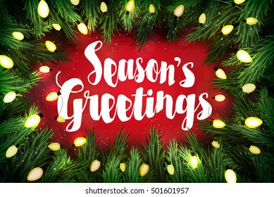 Season's greetings Christmas greeting card with pine wreath and holiday greetings on red