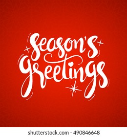 Season's greetings lettering. Modern vector hand drawn calligraphy over red holiday background for your greeting card design