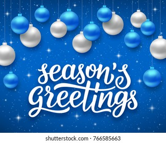 Seasons greetings script text on blue background with sparkles and colorful hanging balls. Vector illustration for holidays with lettering