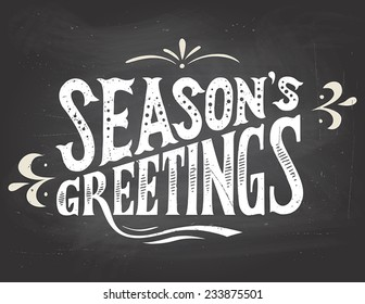 Season's greetings vintage hand-lettering. Hand-drawn typography on blackboard background with chalk
