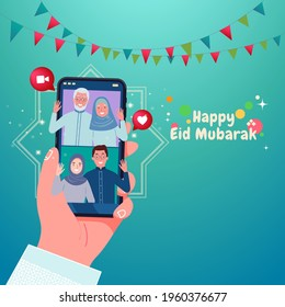 Selamat hari raya Idul Fitri, lebaran or is another language of happy eid mubarak in Indonesian. muslim family blessing Eid mubarak with smart phone on handle screens using video call during Covid-19