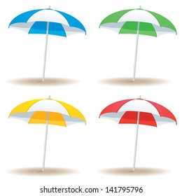 A selection of beach umbrellas in basic colors isolated on white.