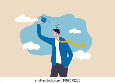 L'amélioration de soi, l'état d'esprit de croissance, l'attitude positive d'apprendre de nouvelles connaissances améliorent la créativité pour le concept de problème commercial, un homme d'affaires intelligent utilisant la canette d'arrosage pour faire pousser des semis sur sa tête.