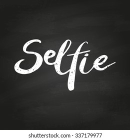 Selfie. Conceptual handwritten phrase. Hand lettered calligraphic design. Brush typography for poster, t-shirt or cards. Vector illustration on chalkboard.