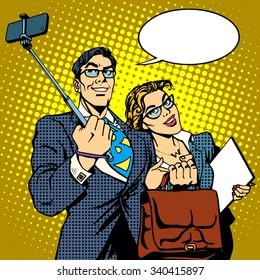 Selfie stick businessman and businesswoman photo smartphone pop art retro style. Couple man and woman friendly photo