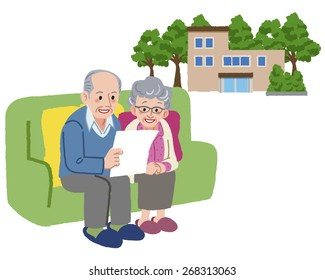 Senior couple talking about cottage or their retirement home.