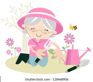 Senior Lady Gardening Grey haired senior woman in the garden suggesting leisure time/retirement/hobby/ relaxing