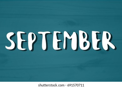 September. Hand drawn lettering on textured background