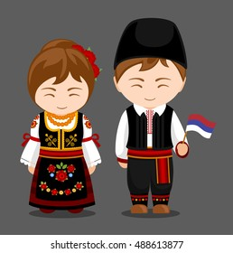 Serbs in national dress with a flag. Man and woman in traditional costume. Travel to Serbia. People. Vector flat illustration.